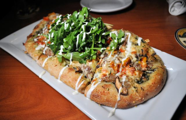 Duck Confit Flat Bread at the Oyster & Thistle.