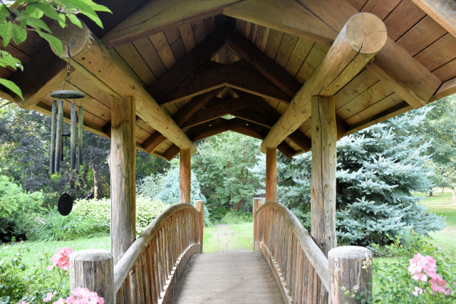 Bridge in the gardens at Village Green Resort.