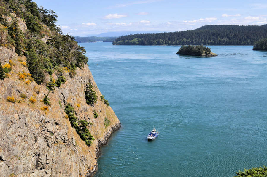 a boat in deception pass state park with little islands out in the water
