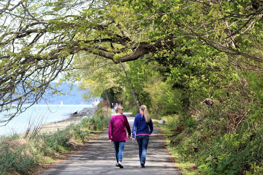 Walkers o the Geumes Channel Trail in Anacortes, Washington
