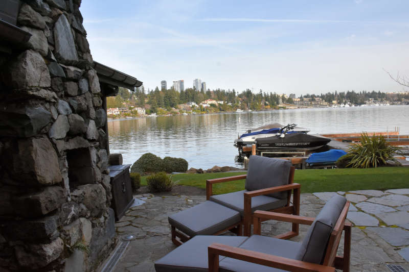 A lakside cabin with outdoor patio and a view of Bellevue, Washington.