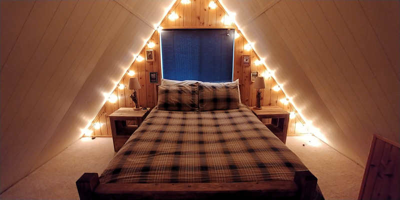 Queen bed in the loft at Millard's Cabin in Packwood, Washington..