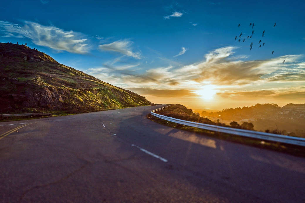 Winding road with a sunset.