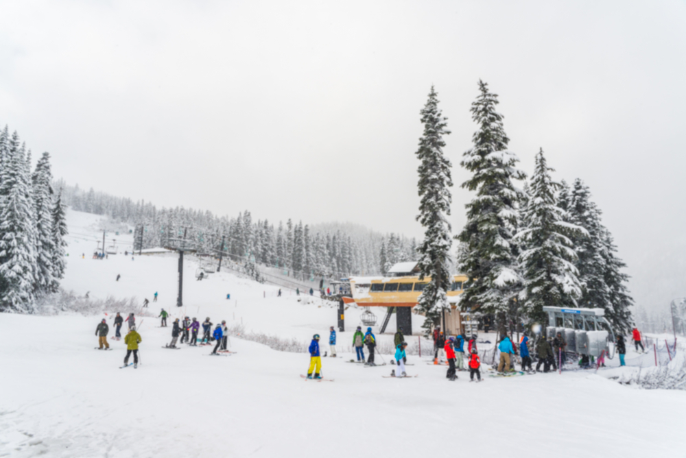 Lots of skiers gathering around a chairlift at Stevens Pass Ski Area close to Leavenworth Washington