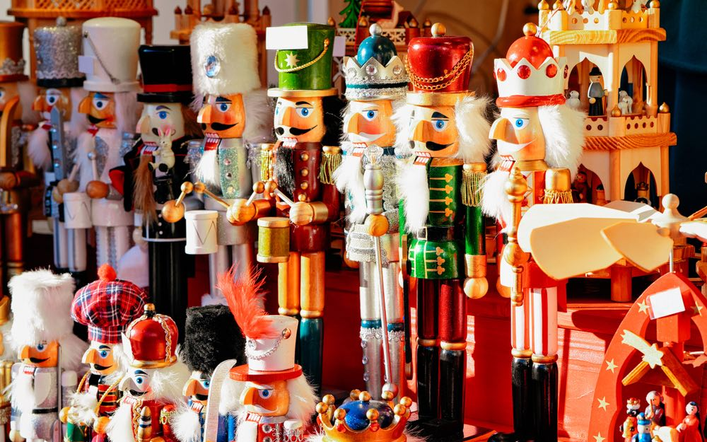 A collection of nutcrackers in a variety of colors and sizes in a Christmas style