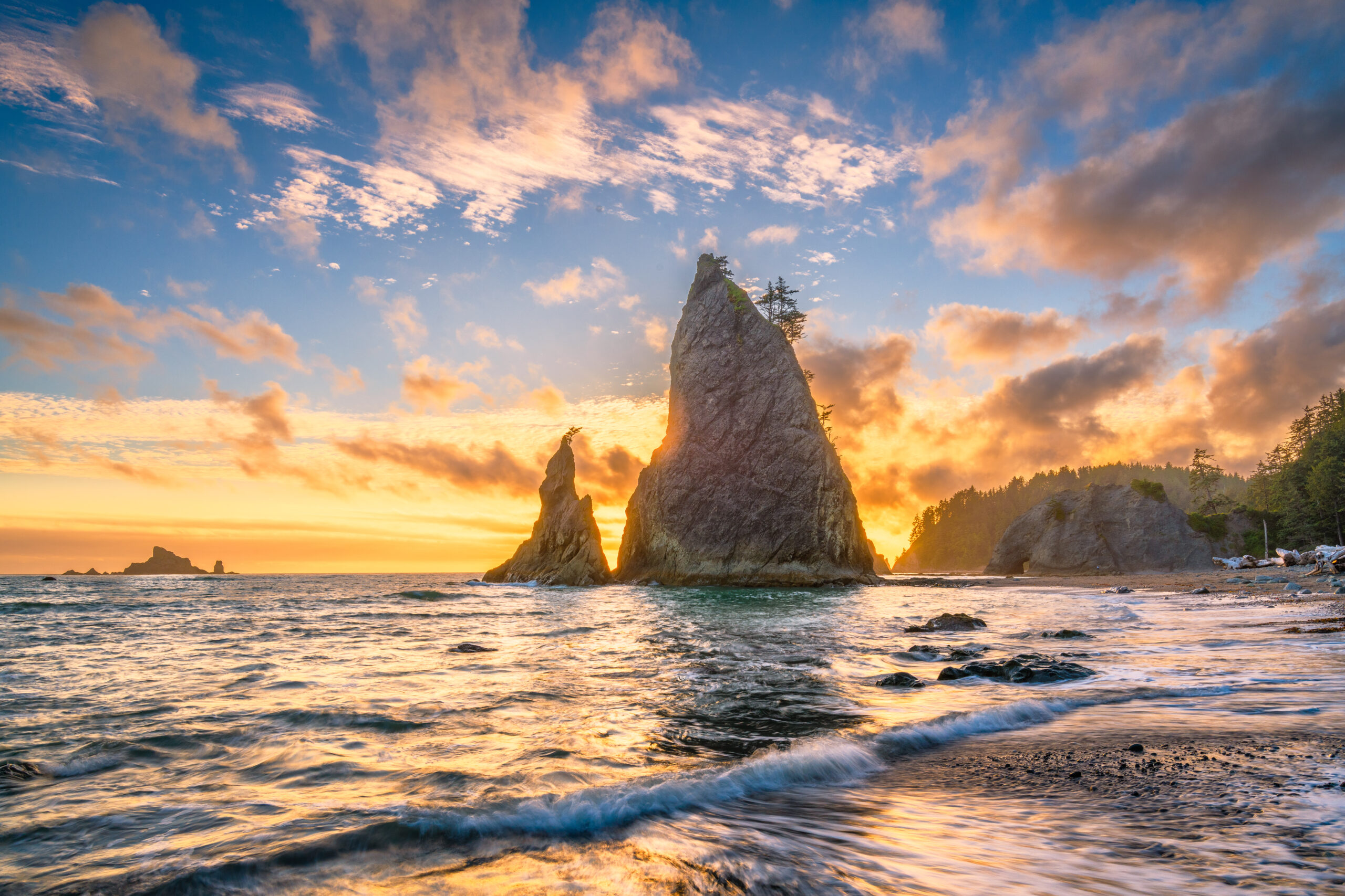 sunset over rialto beach with a haystack in the center, one of the best washington beaches