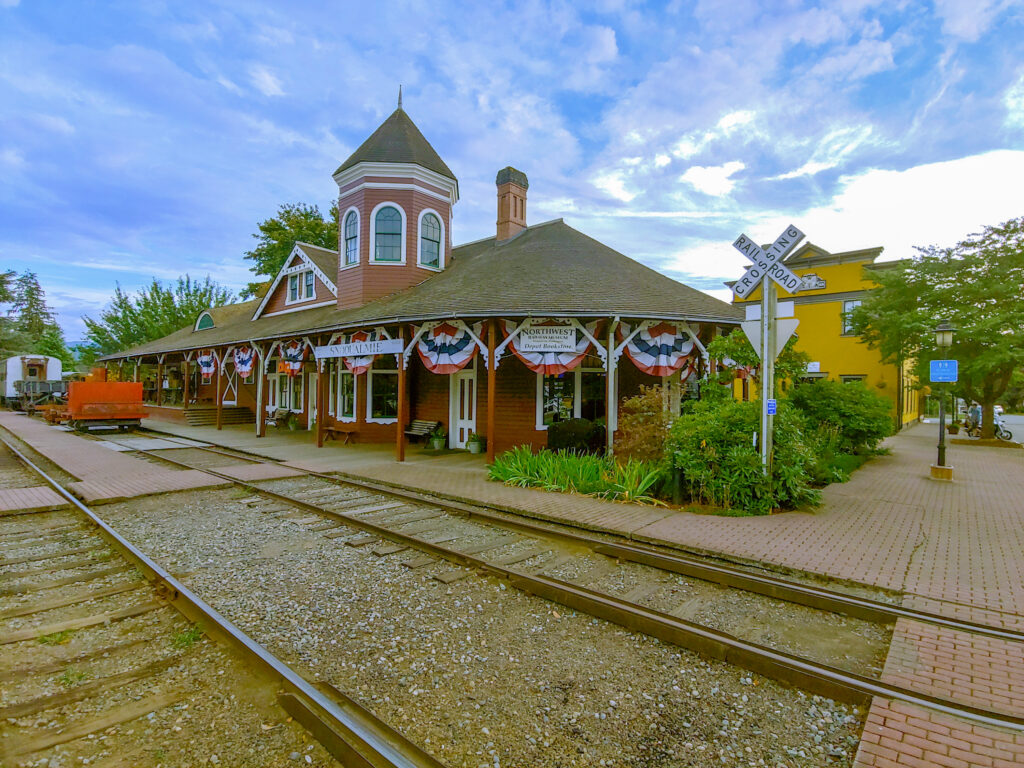 snoqualmie depot on a sunny day, decorated with american flags
