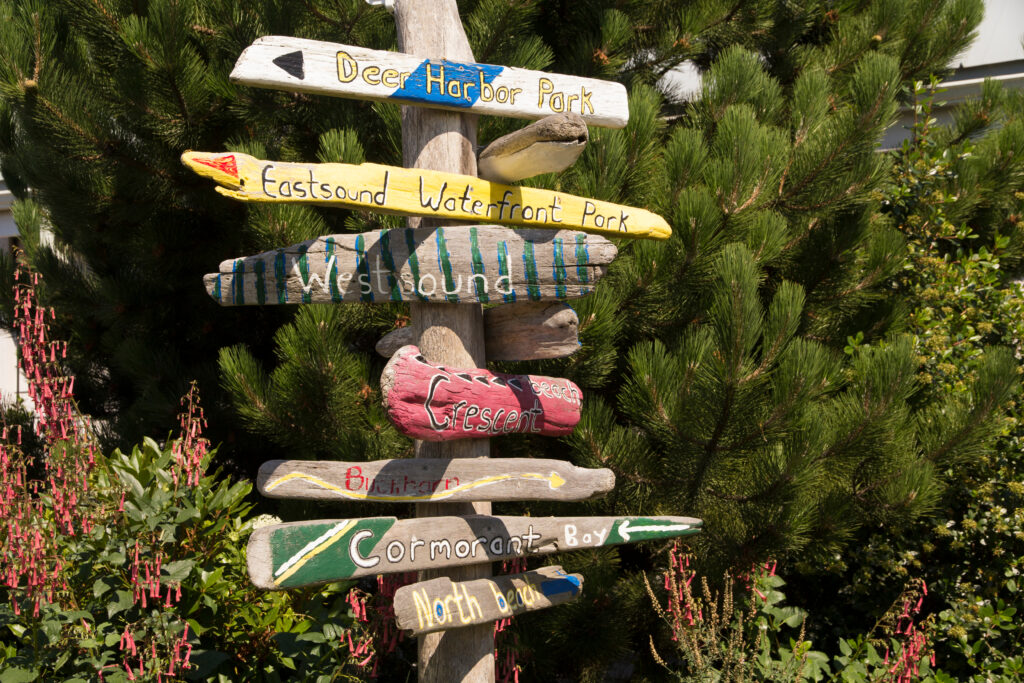 colorful painted wooden signs pointing to different places to visit in eastsound washington state