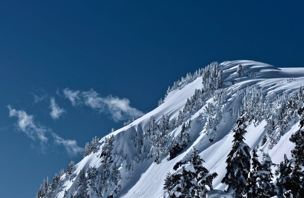 A view of the snow-covered mountains on a sunny winter day hiking in Washington State's famous Artist's Point area.