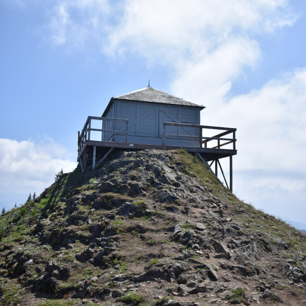 old white wood fire lookout stand at kelly butte lookout, one of the best hiking trails close to seattle