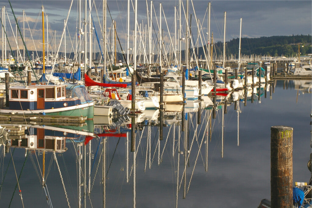 sailboats partked in anacortes harbor under stormy skies