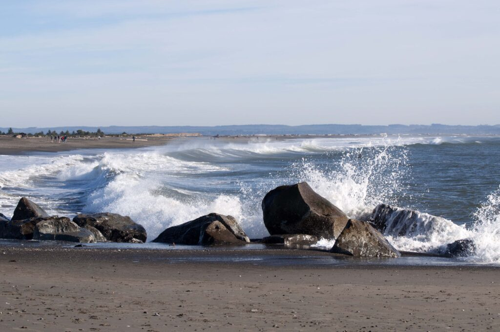waves crashing against rocks on the beach at ocean shores washington state