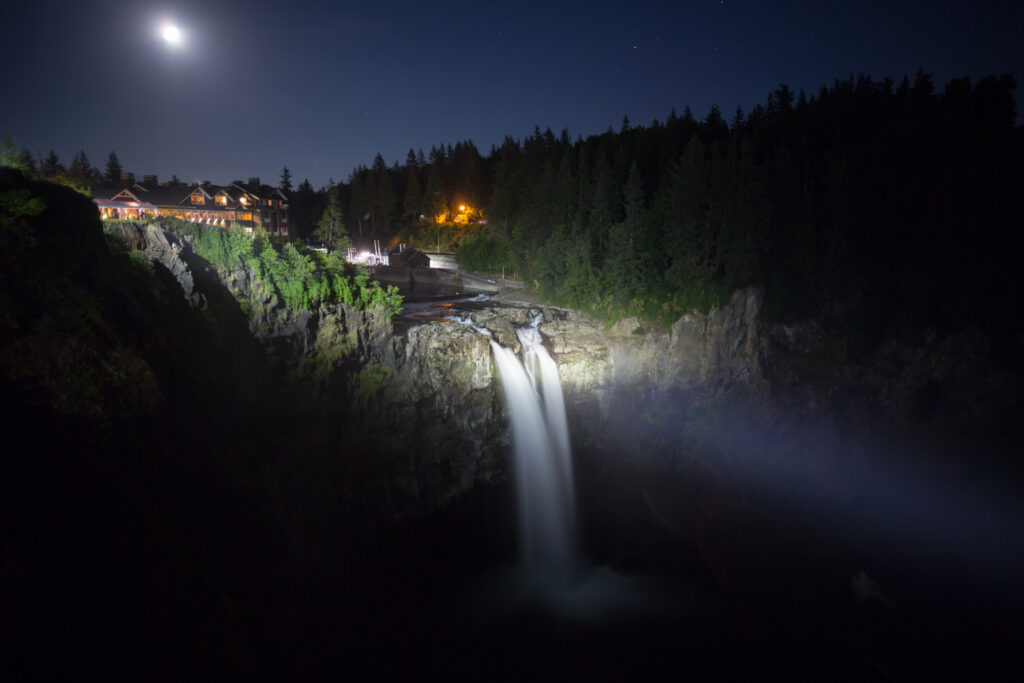 snoqualmie falls, as seen illuminated at night