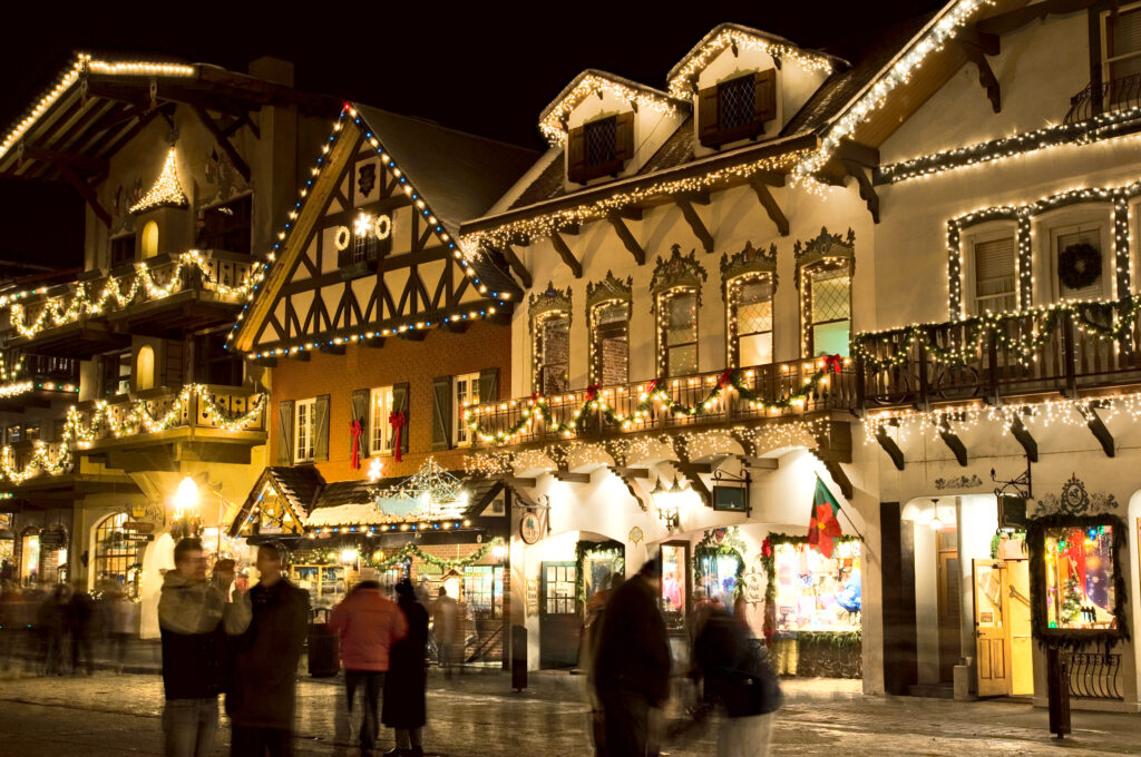 leavenworth in winter at night with christmas lights on the buildings