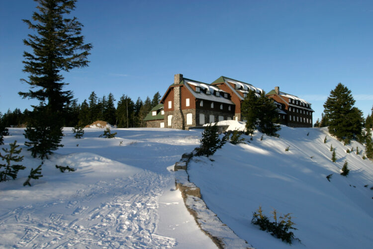 crater lake lodge at rim village in winter with heavy snow