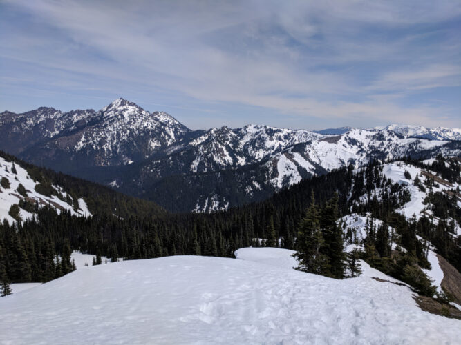 The snowshoe path to Hurricane Hill from the Hurricane Ridge Visitor Center covered in snow with footprints in the winter.