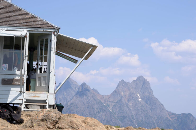 white fire lookout house on desolation peak