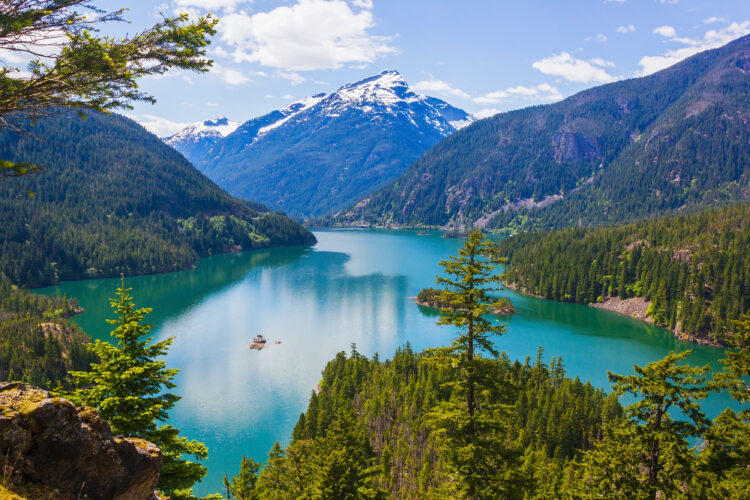 diablo lake, one of the best hikes in north cascades np with a snowcapped mountain in the distance