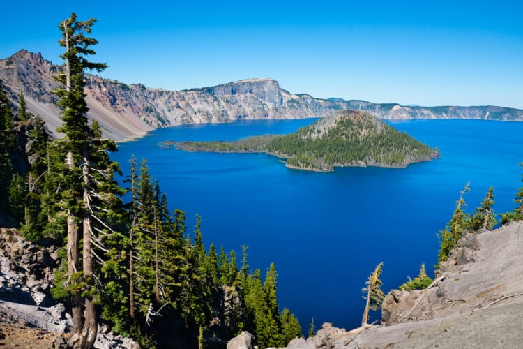overview of crater lake np seen from above with blue water and island in lake