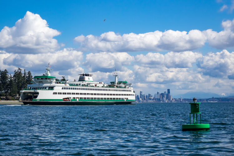 bainbridge seattle ferry on the water with seattle skyline in the background