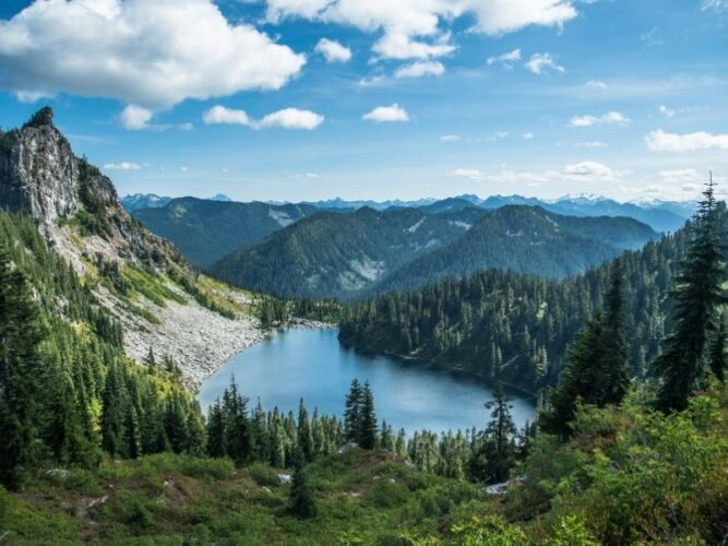 View of the turquoise pale blue Valhalla Lake as seen from Mt McCausland