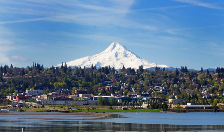 hood river oregon as seen from across columbia river with mt hood in background, one of the best small towns in oregon