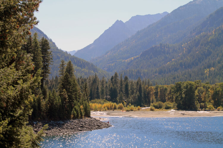 wallowa lake oregon with forested mountains in the background