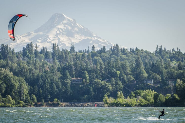 kitesurfer in columbia river with mt hood in background