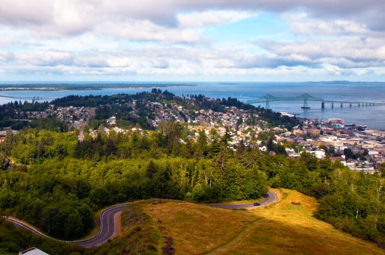 astoria oregon with winding road in the foreground