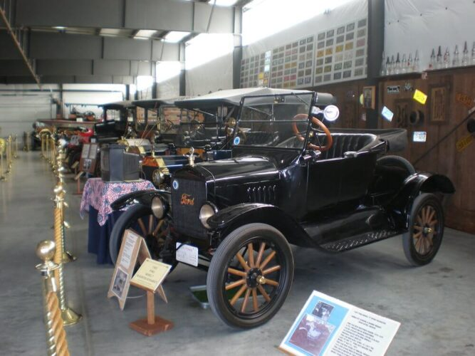 Old antique cars in black colors, convertible, in a showroom at a museum