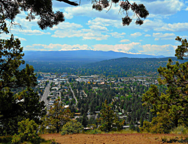 View from the top of Pilot Butte looking over downtown Bend, an easy hike near Bend Oregon on a sunny day