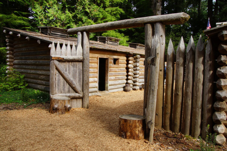 Stockade fence of Fort Clatsop, re-construction at Lewis and Clark National Historical Park, Oregon, made of wooden poles and logs.