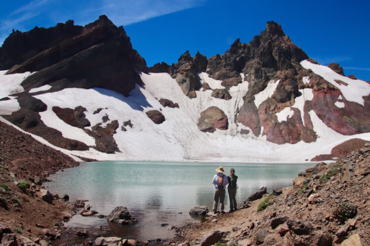 """Two Bend hikers reach No Name Lake aka the """"Bend Glacier"""" while hiking on a summer day"""