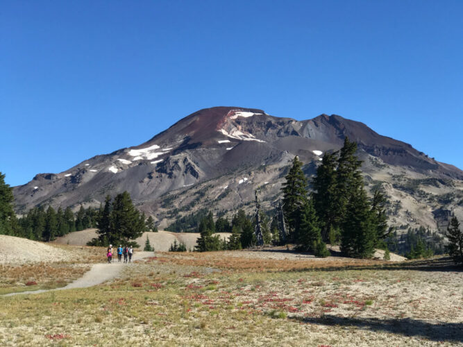 Hiking trail near Bend, Oregon on the way to South Sister volcano, with some snow patches, on a super sunny day.