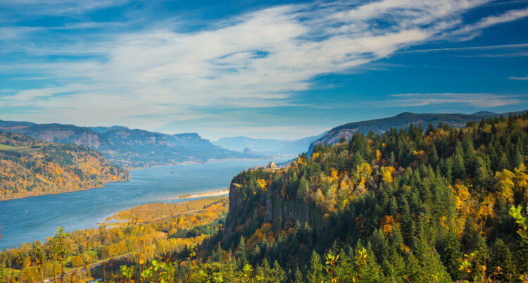 View of the Columbia River Gorge, with fall foliage, on a sunny day with some clouds.