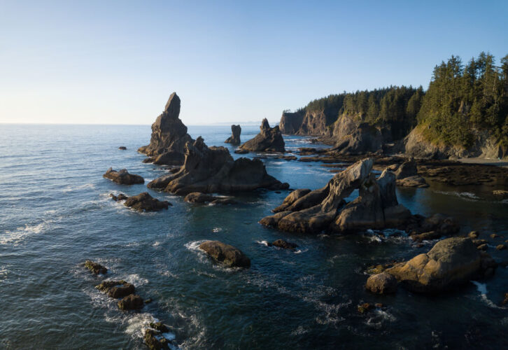 Beautiful aerial view of a scenic landscape at the Ocean Coast, with rock formations in the Pacific Ocean. Taken at Shi Shi Beach in Neah Bay, West of Seattle, Washington, United States of America.