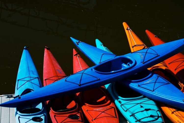 a stack of kayaks in the water at poulsbo