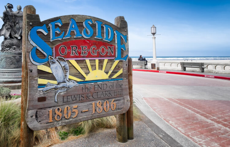 "Sign that reads ""seaside oregon the end of the lewis and clark trail 1805-1806"" on the beachfront"