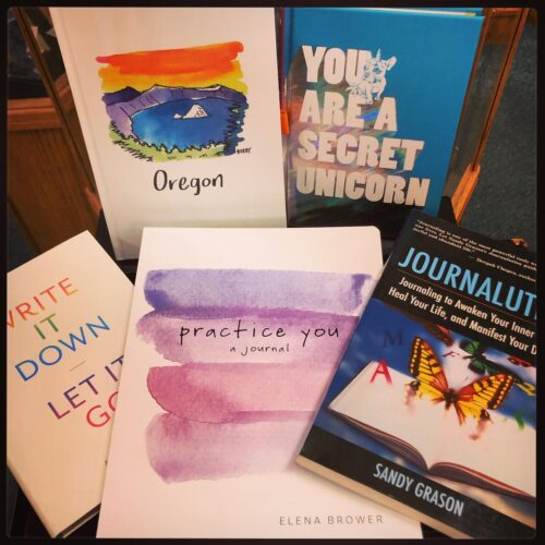 a selection of journals and personal development books at a hippie bookstore in portland