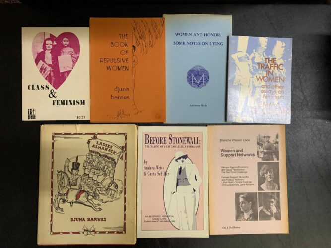 a selection of used books on feminism