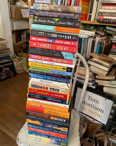 a stack of books on a chair