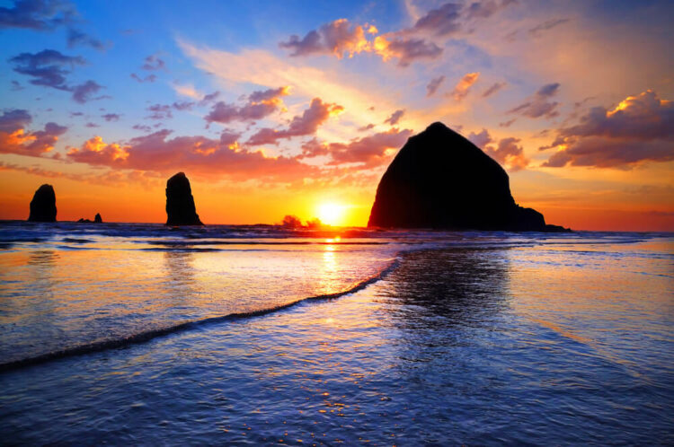 Sunset at Haystack Rock an enormous rock off the Oregon coast in Cannon beach