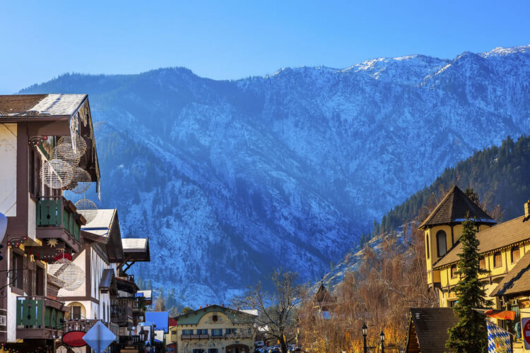 The scenic Bavarian mountain town of Leavenworth Washington with a mountain above it