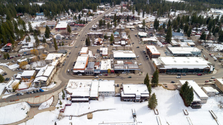 photo of the town of mccall idaho seen from above, an aerial photo in the winter with some light snow on the rooftops and ground