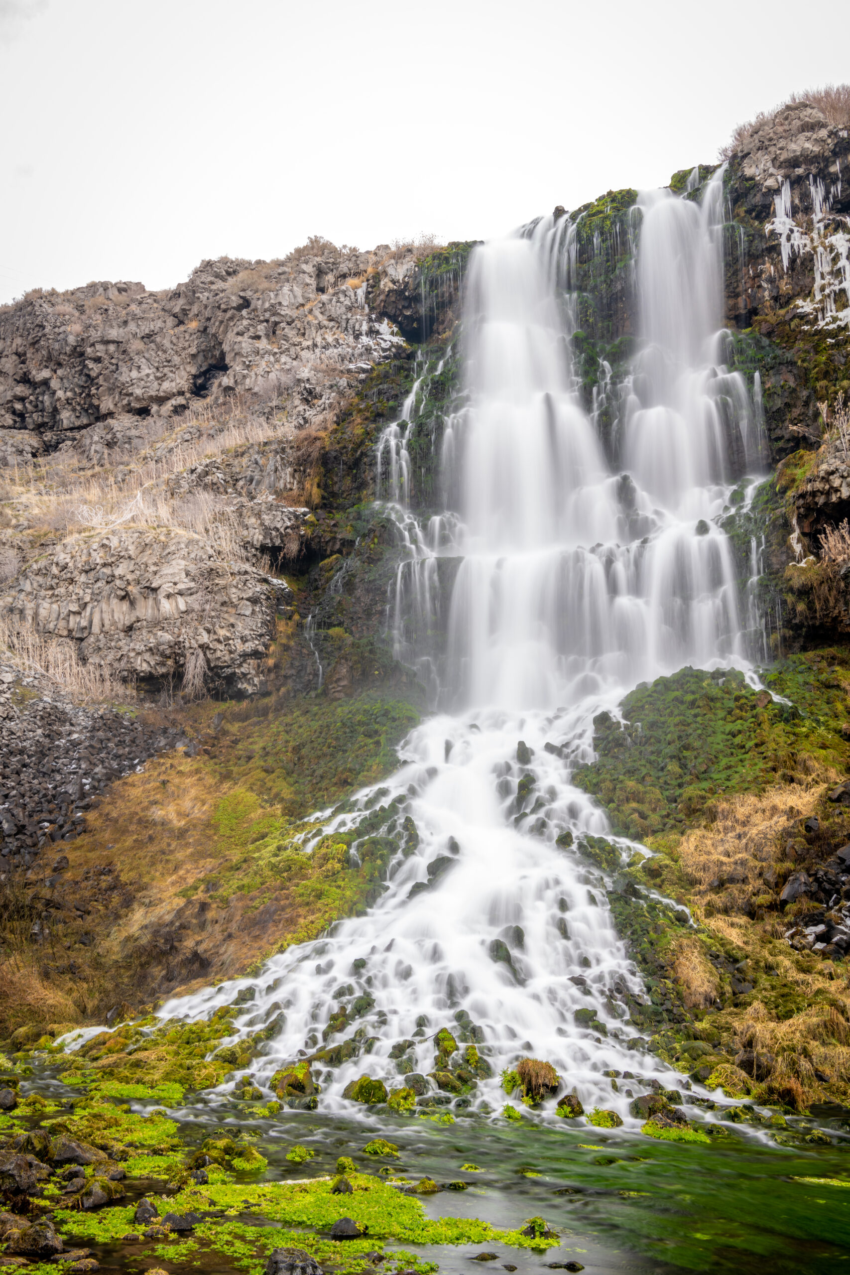 ritter island waterfall in thousand springs state park on a cloudy day, one of the most beautiful waterfalls idaho