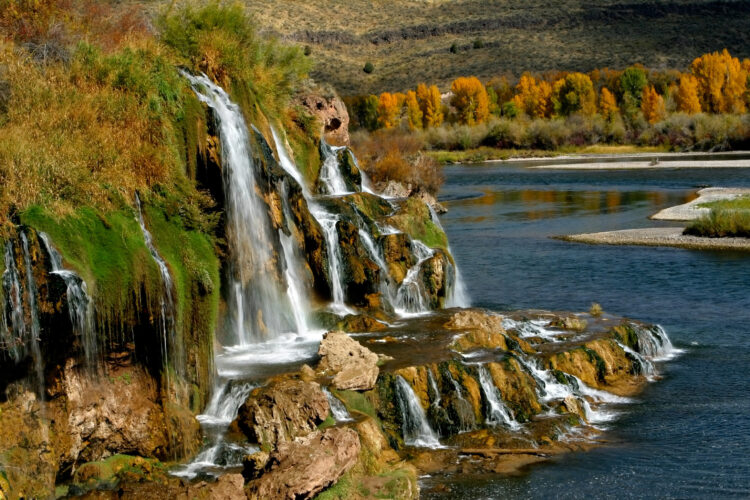 fall creek falls, one of the best waterfalls in idaho, as seen from the side during the fall