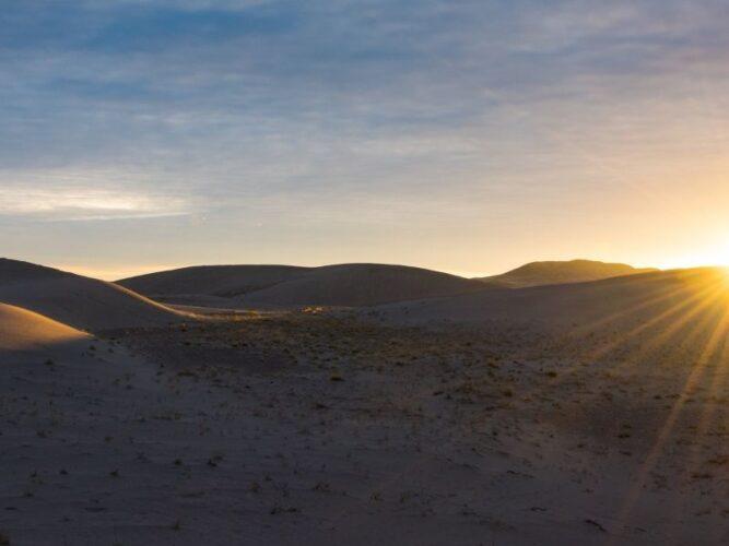 sun rising over the idaho sand dunes on a cool getaway in idaho